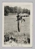 view Photograph of a woman, Chickie, standing in a field digital asset number 1