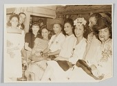 view Photograph of a group of men and women taken at the Ubangi Club digital asset number 1