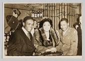 view Photograph of two men and a woman taken at the Ubangi Club digital asset number 1