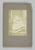 view Albumen print of an unidentified woman sitting on stairs digital asset number 1
