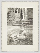view Photographic print of an unidentified girl sitting on a lawn digital asset number 1