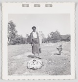 view Photographic print of a woman standing by a gravesite digital asset number 1