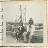 view Digital image of Taylor family members by a docked sailboat on Martha's Vineyard digital asset number 1