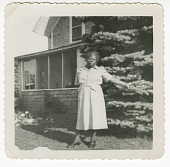 view Digital image of a woman outside the Taylor family home on Martha's Vineyard digital asset number 1