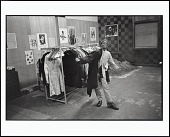 view <I>Free Clothing Program, A Boy Tries on a Coat at a Party Office, Toledo, Ohio, 1971</I> digital asset number 1