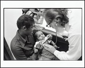 view <I>Doctor Examines Baby at Health Clinic Run by the Black Panther Party, Chicago, Illinois, 1970</I> digital asset number 1