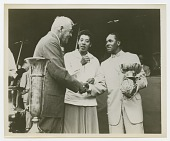 view Photograph of Althea Gibson standing next to two men shaking hands digital asset number 1