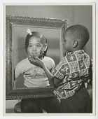 view Print of a young girl and boy posing with a picture frame digital asset number 1