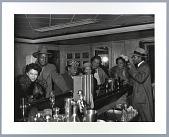 view Photograph of seven patrons at a bar digital asset number 1