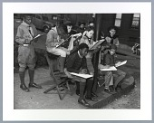 view Photographic print of Boy Scouts with notepads on sidewalk digital asset number 1