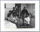 view Photographic print of the Berry family gathered around pot belly stove digital asset number 1