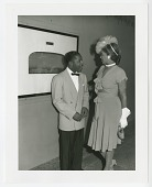 view Photographic print of Erroll Garner speaking to a woman digital asset number 1
