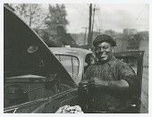 "view Photographic print of auto mechanic Sam ""Scotty"" Scott digital asset number 1"