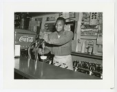 view Photographic print of a soda jerk working in a soda shop digital asset number 1