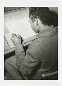 view Photograph of a St. Augustine High School student drawing in art class digital asset number 1