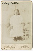 view Photograph of Larby Smith standing next to a wicker chair. digital asset number 1