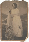 view Photographic print of a woman in a white dress posing next to column digital asset number 1