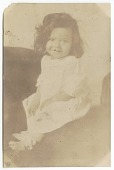 view Photographic print of a toddler girl sitting and smiling at the camera digital asset number 1