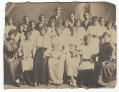 view Photographic print of a group of young men and women standing in 3 rows digital asset number 1