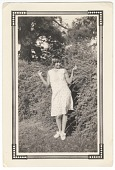 view Photographic print of a woman posing in front of bushes digital asset number 1