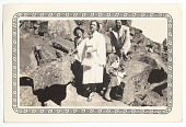 view Photographic print of Eunice Jackson and friends posing in front of large rocks digital asset number 1