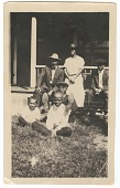 view Photographic print of of 3 men, 2 boys and 1 woman posing on a porch digital asset number 1