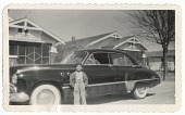 view Photographic print of young boy standing in front of a car digital asset number 1