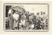 view Photographic print of a large group of people posing outside of a house digital asset number 1