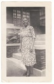 view Photographic print of Irene Banks standing in front of a brick building digital asset number 1