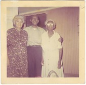 view Chromogenic print of a man standing with his arms around two ladies digital asset number 1