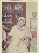 view Chromogenic print of an elderly woman sitting in a chair digital asset number 1