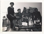 view Photographic print of four women sitting on a couch digital asset number 1