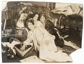 view Photographic print of 4 women sitting in front of a sofa digital asset number 1