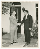 view Photograph of Gilbert E. DeLorme. Sr., shaking hands with an unidentified man digital asset number 1