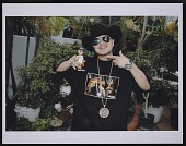 """view Photograph of Chingo Bling on the set of Pitbull's """"Toma"""" video shoot digital asset number 1"""