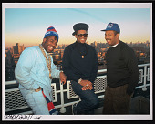 view Photograph of Run-D.M.C. on the rooftop of Russell Simmons's apartment digital asset number 1