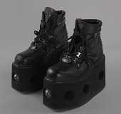 view Black platform ankle boots worn by Bootsy Collins digital asset number 1