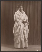 view Gelatin silver print of a woman in a ruffled dress digital asset number 1
