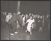view Gelatin silver print of a couple dancing in front of a crowd digital asset number 1