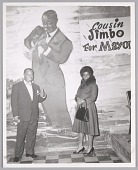 view <I>Mr. & Mrs. Louis Armstrong pose in front of his Bop City mural</I> digital asset number 1
