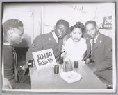 view <I>Popular Bop City waitress poses with military men, c. 1952</I> digital asset number 1