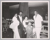 view <I>Philippe Wynne and Purvis Jackson of the The Spinners with Linda Jackson and the wife and daughter of radio DJ Detroit Benson, Circle Star Theater, June 1973</I> digital asset number 1
