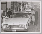 view <I>Ford automobile dealer, Mr. Ollison with satisfied customer, date unknown</I> digital asset number 1