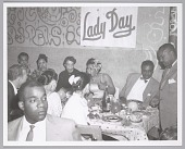 """view <I>Billie Holiday at a dinner party under a """"Lady Day"""" sign</I> digital asset number 1"""