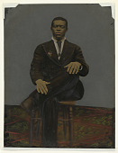 view Tintype of a man wearing a suit with a pendant on the lapel digital asset number 1