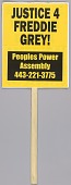 """view Placard reading """"Stop racism now"""" used at Baltimore protests digital asset number 1"""