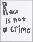 "view Poster reading ""Race is not a crime"" used at Baltimore protests digital asset number 1"