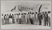 view Photographic print of migrant workers in front of a plane digital asset number 1