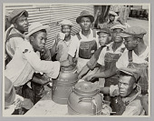 view <I>WASECA – BARBADOS ISLAND STORY: FILLING UP COFFEE CUPS AT THE COFFEE URNS AT THE END OF CHOW LINE</I> digital asset number 1
