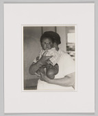 view Portrait of an unidentified cafeteria worker and unidentified baby digital asset number 1